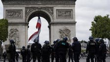 Police fire tear gas to disperse protesters from Champs-Elysees