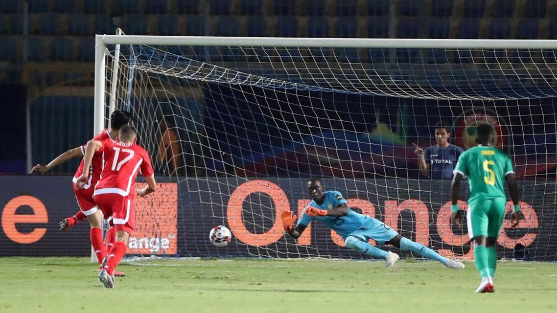 Senegal's Alfred Gomis saves the penalty of Tunisia's Ferjani Sassi  in the Africa Cup of Nations 2019 semi-final match at the 30 June Stadium, Cairo, on July 14, 2019. (Reuters)