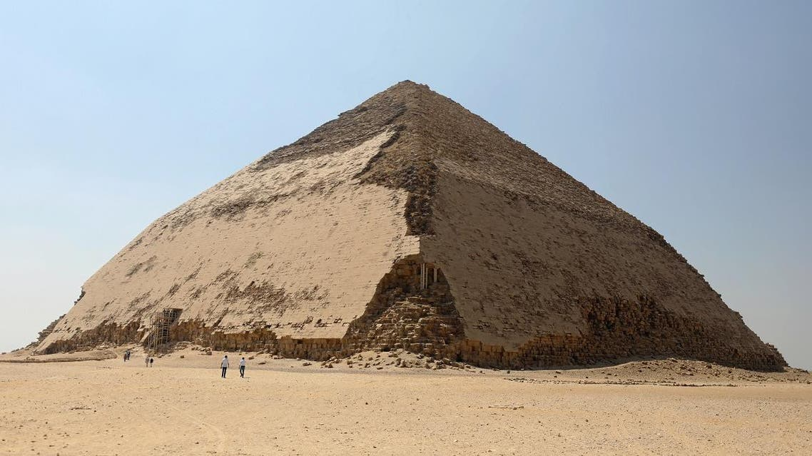 People walk in front of the Bent Pyramid of Sneferu, that was reopened after restoration work, in Dahshur, south of Cairo. (Reuters)