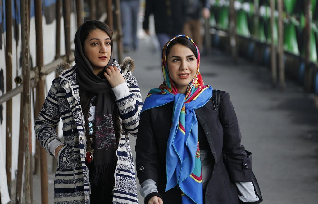 In Iran, some take off their hijabs as hard-liners push back
