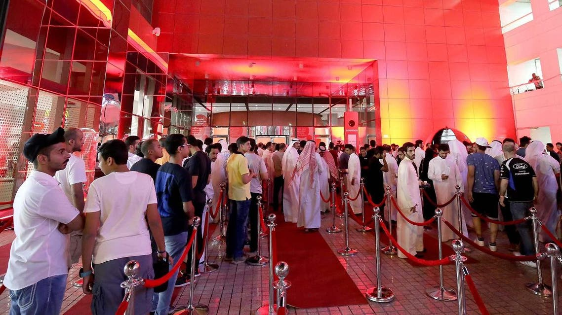 A crowd of people wait outside a telecommunications company headquarters to purchase the new Apple iPhone 8 in Kuwait City. (File photo:AFP)