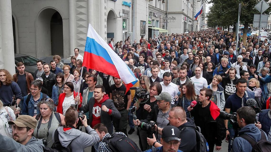 Russian opposition figure Ilya Yashin leads his supporters at a rally to protest against alleged violations ahead of elections to Moscow City Duma, the capital's regional parliament, in Moscow, on July 14, 2019. (Reuters)