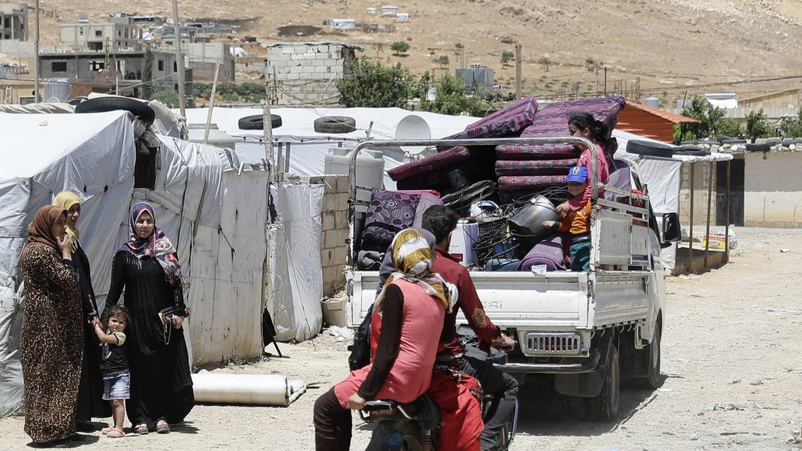 A picture taken on June 10, 2019, shows a Syrian refugee camp in the northeastern town of Arsal in Lebanon's Bekaa valley. Lebanon's planned demolition of concrete shelters housing Syrian refugees near the border could make at least 15,000 children homeless, aid groups warned Tuesday. The authorities in April set a June 9 deadline for Syrian refugees living in shelters built with materials other than timber and plastic sheeting in Arsal to bring their homes into compliance.