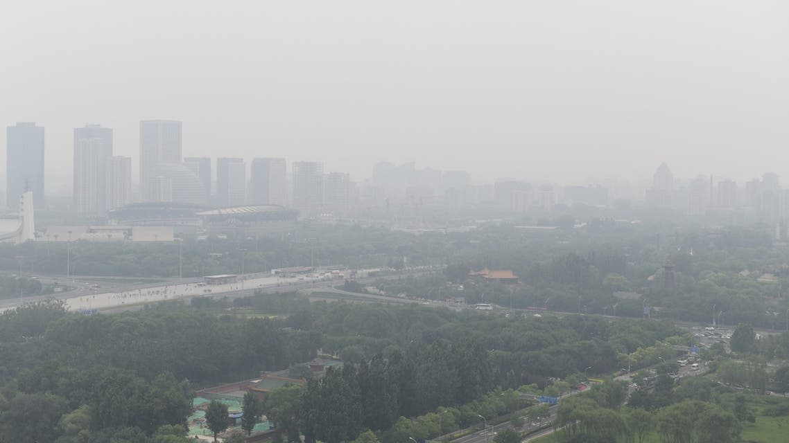 A general view shows Olympic Forest Park (bottom), built for the 2008 Beijing Olympic Games, on a polluted day in Beijing on June 21, 2019.