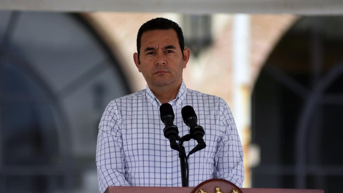 Guatemalan President Jimmy Morales listens to Honduran President Juan Orlando Hernandez (out of frame) during a joint press conference at the Guatemalan Air Force base, near Guatemala City on October 20, 2018 (AFP)