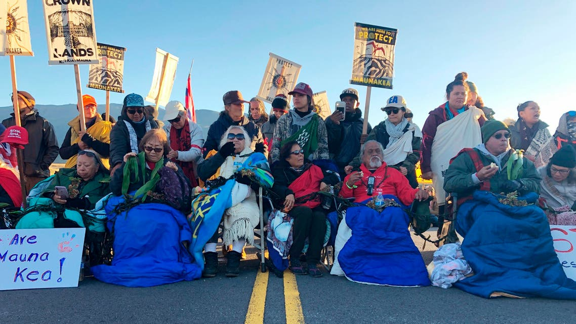 Demonstrators gather to block a road at the base of Hawaii's tallest mountain, Monday, July 15, 2019, in Mauna Kea. (AP)