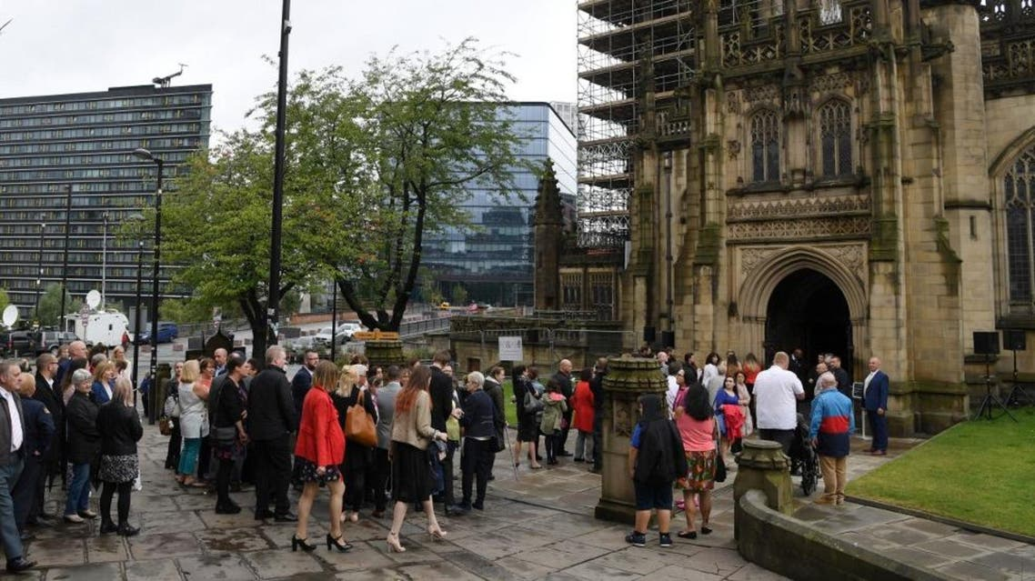 Funeral attendees, who were requested to bring a rose, arrive for the funeral of Manchester Arena bomb victim Saffie-Rose Roussos AFP