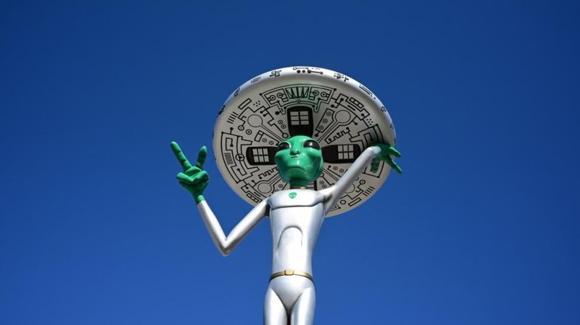In this file photo taken on March 4, 2019, an Alien sculpture lines the side of the road in the town of Baker, California, known as the 'Gateway to Area 51.' AFP