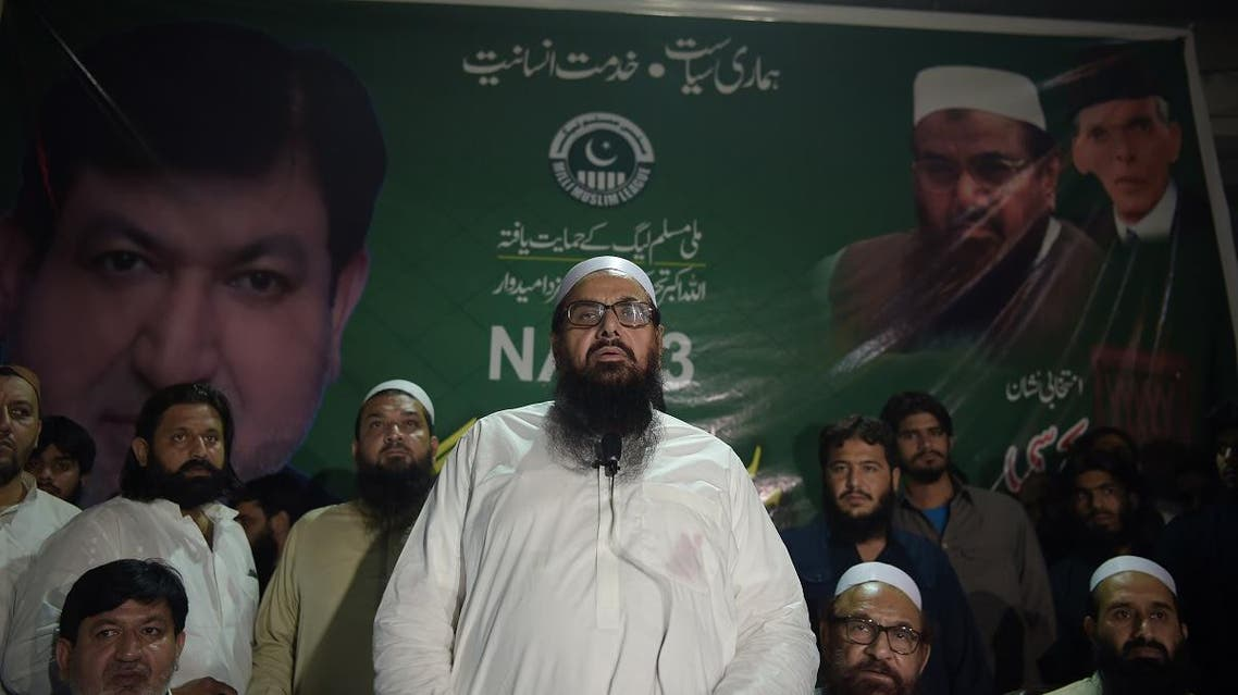 The head of Pakistani militant organization Jamaat-ud-Dawa (JuD) Hafiz Saeed (C) speaks to supporters. (File photo: AFP)