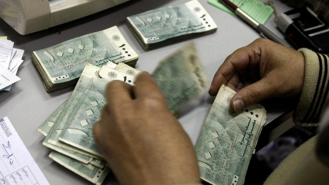 An employee at Lebanon's Central Bank counts money bills at his office in Beirut on November 24, 2008. (AFP)