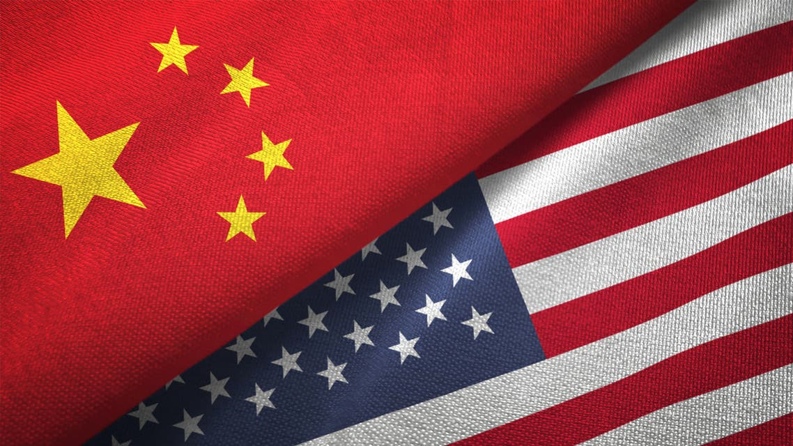 American and Chinese flags on crumpled paper, diplomatic crisis stock photo