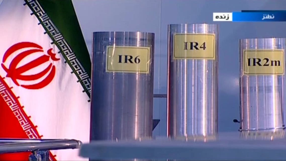 In this June 6, 2018 frame grab from Islamic Republic Iran Broadcasting, IRIB, state-run TV, three versions of domestically-built centrifuges are shown in a live TV program from Natanz, an Iranian uranium enrichment plant, in Iran. The program from made a point to show the centrifuges labeled in English in the background. Those shown Wednesday night are more-sophisticated devices Tehran is currently prohibited from running under the nuclear deal with world powers. (IRIB via AP)