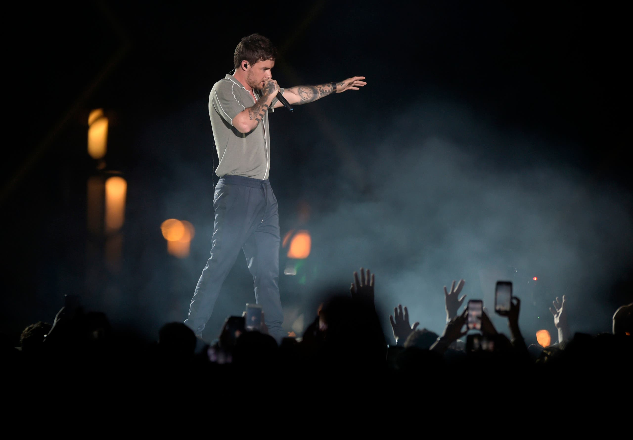 Fans wave to Liam Payne as he performs at the King Abdullah Sports Stadium, in Jeddah, Saudi Arabia, during the concert of Jeddah World Fest, late Thursday, July 18, 2019.  (AP)