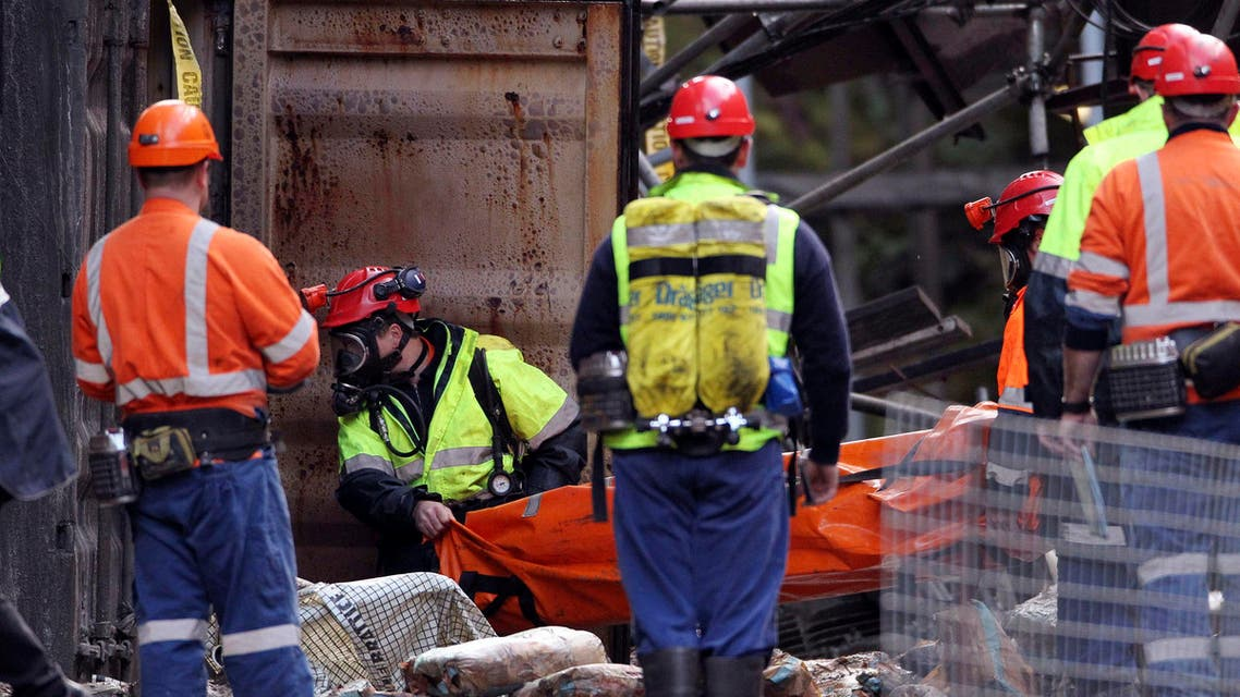 Rescue workers enter the Pike River mine at Greymouth, New Zealand, Tuesday, June 28, 2011 (AP)