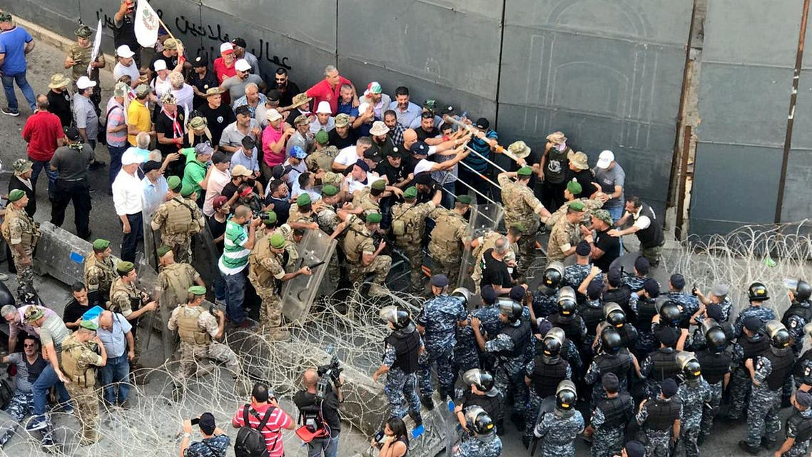 Veterans tussle with the Lebanese army and police during a protest over cuts to their pension service at downtown Beirut, Lebanon July 19, 2019. REUTERS/Maria Semerdjian