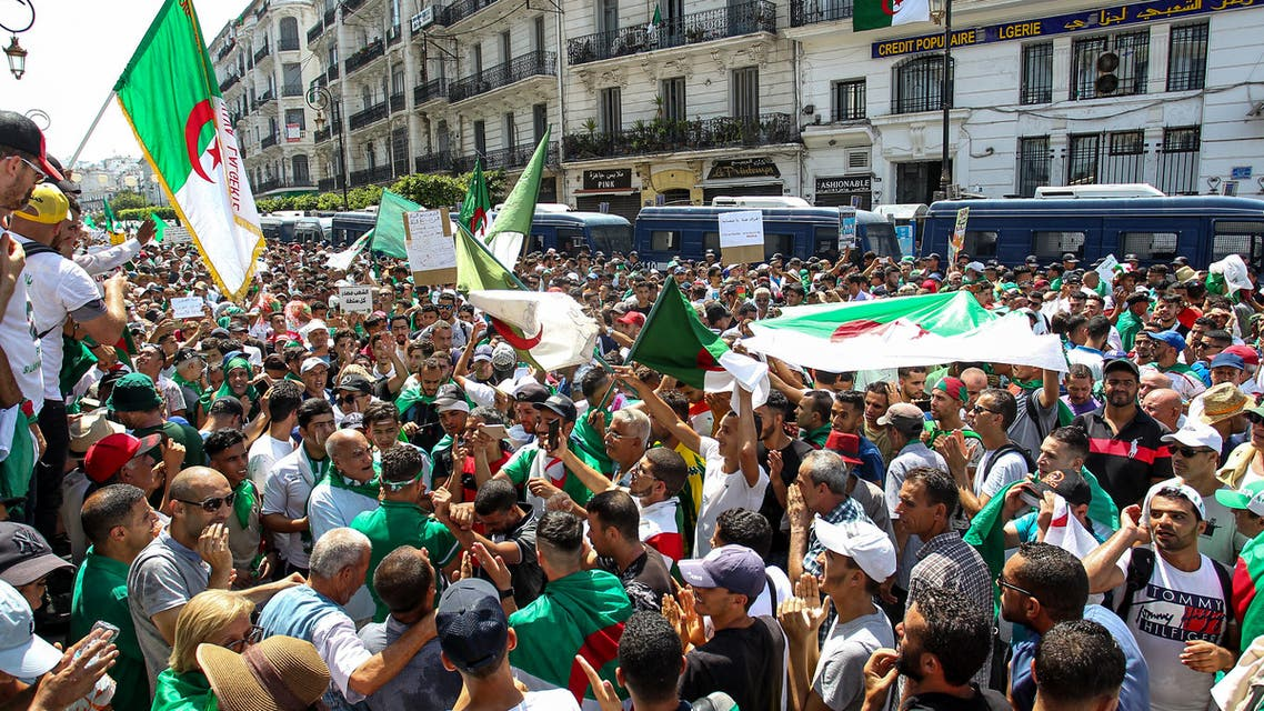 Algerian demonstrators chant slogans as they gather in the streets of the capital Algiers against the ruling class amid an ongoing political crisis in the country, on the 22nd consecutive Friday protest on July 19, 2019, coinciding with the Egypt 2019 Africa Cup of Nations final match between Algeria and Senegal. In April, long-standing president Abdelaziz Bouteflika resigned after weekly Friday protests against his expected candidacy for elections, and football fans have been heavily involved in demonstrations.