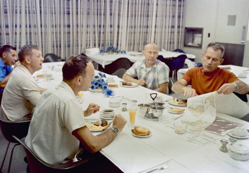 "In this image obtained from NASA, Apollo 11 astronauts Neil Armstrong (2nd L), Michael Collins (3rd L) and Buzz Aldrin (C) have their pre-launch breakfast on July 16, 1969, with astronaut William Anders (L) and Chief of the Astronaut Office Donald K. ""Deke"" Slayton. (AFP)"