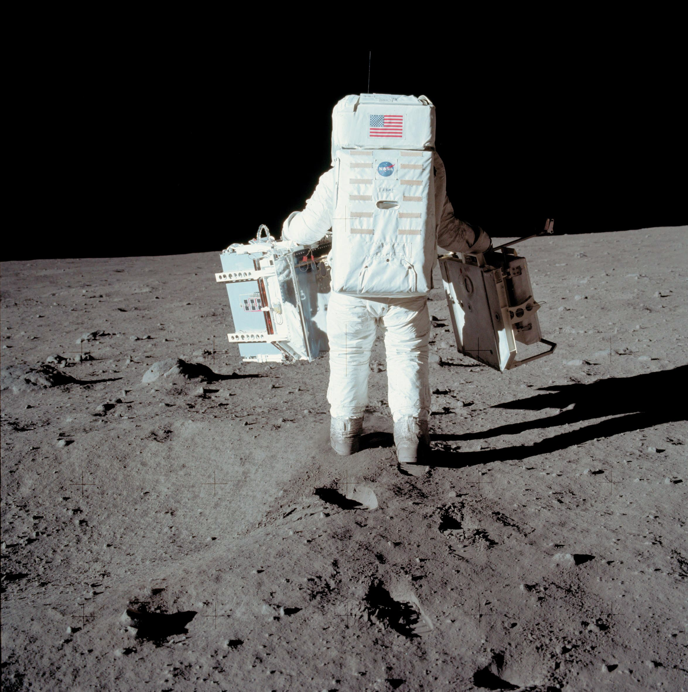 In this image from NASA on July 20 1969, Apollo 11 space mission US astronaut Buzz Aldrin conducts experiment on the moon's surface on a picture taken by Neil Armstrong, after both climbed down the ladder of the lunar module. (AFP)