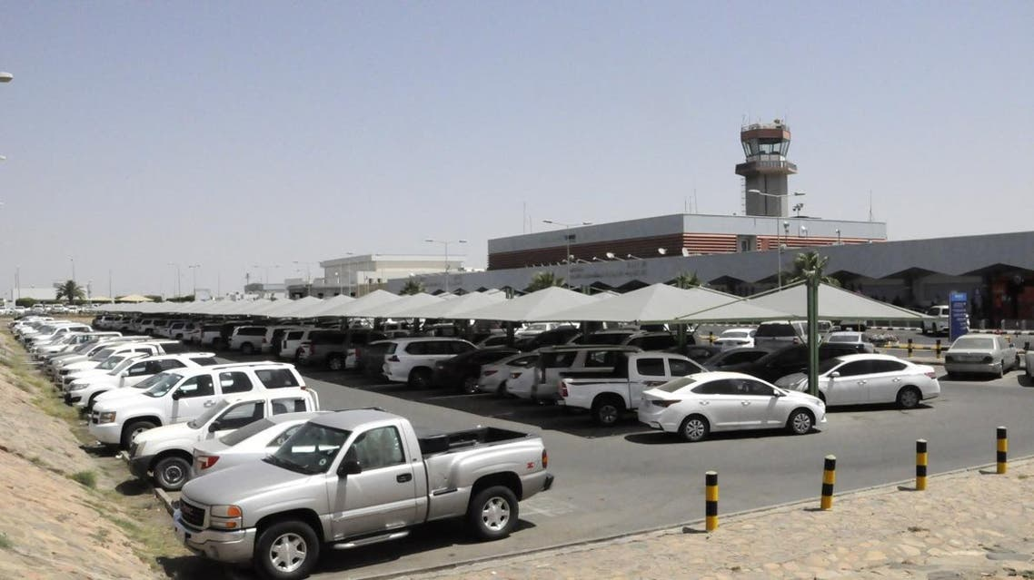 Cars are parked outside the Abha airport in the southern Saudi Arabian popular mountain resort of the same name, on July 2, 2019. A Yemeni rebel attack on the civilian airport wounded nine civilians today, a Riyadh-led coalition said, the latest in a series of strikes on the site. AFP