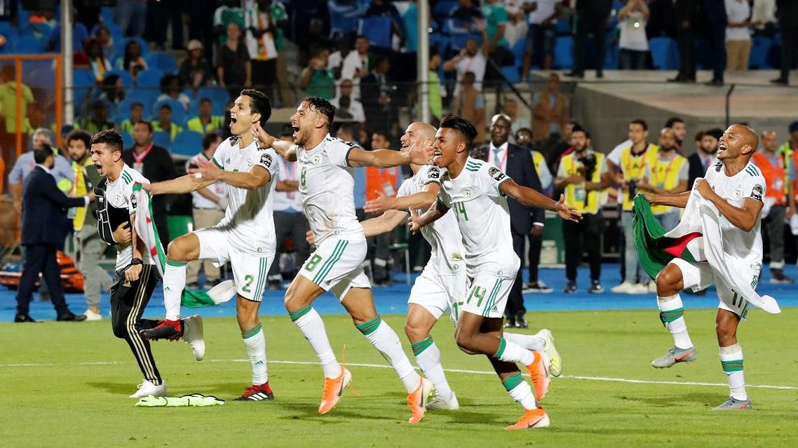 Algeria's Youcef Belaili with team mates celebrate in front of their fans after winning the Africa Cup of Nations against Senegal at the Cairo International Stadium, Egypt, on July 19, 2019. (Reuters)
