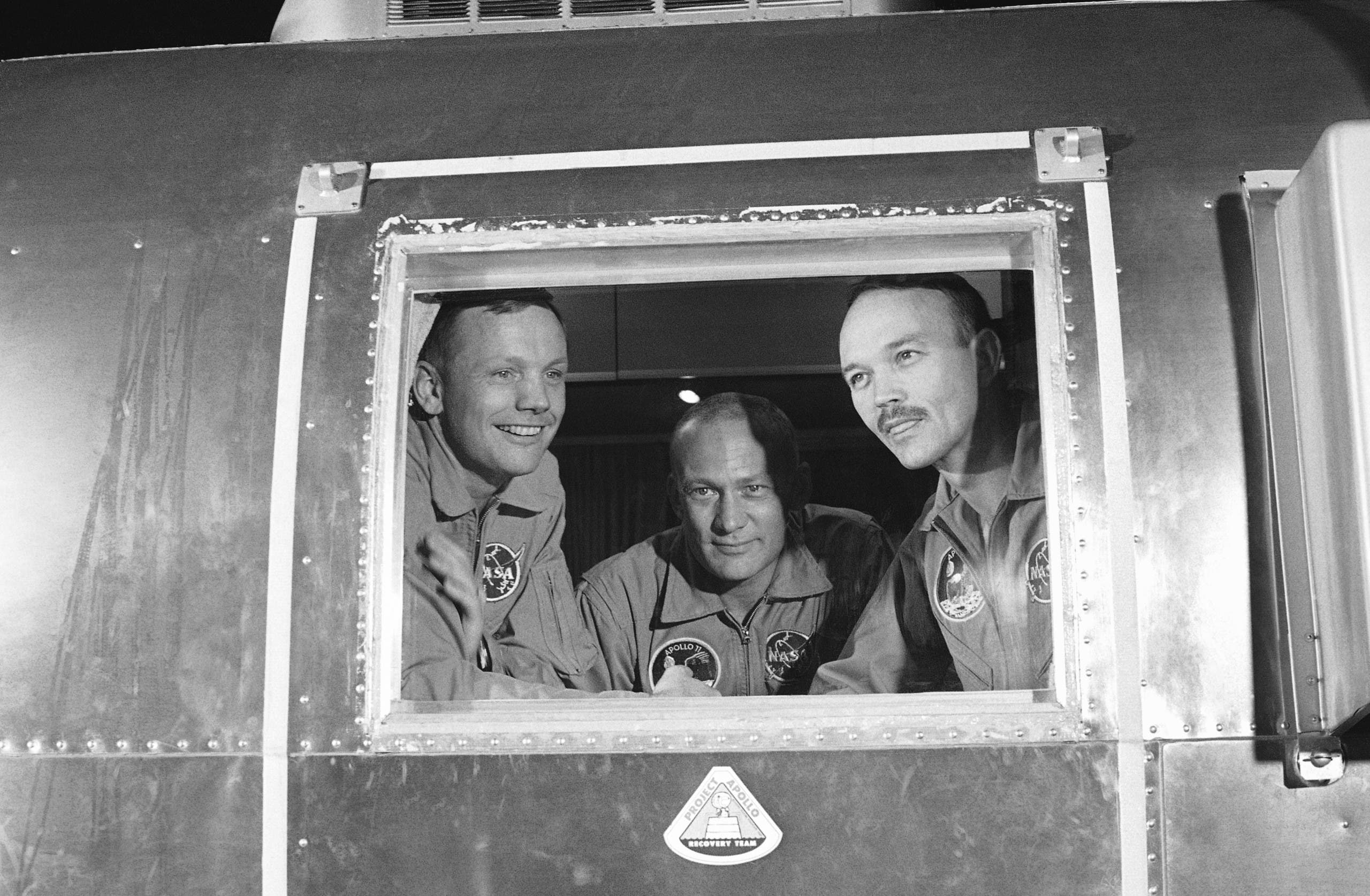 In this July 27 1969 file photo, Apollo 11 crew members Neil Armstrong, Buzz Aldrin and Michael Collins sit inside a quarantine van in Houston. (AP)