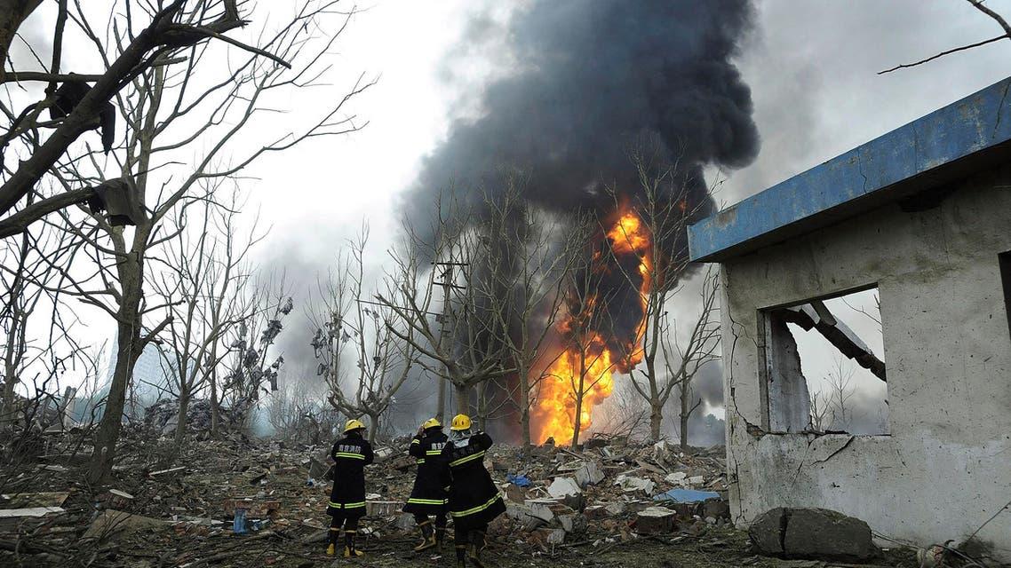 Firemen walk past debris after a factory explosion in Nanjing, in east China's Jiangsu province, Wednesday, July 28, 2010.  (AP)