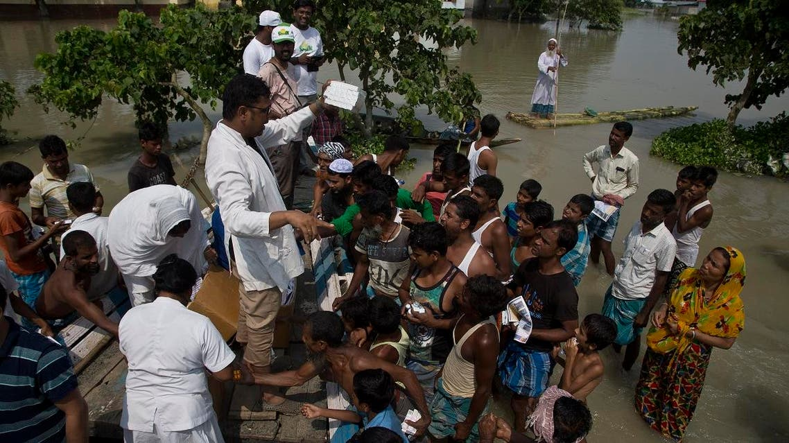 Medical officers distribute medicines to flood victims in Gagalmari, in the northeastern Indian state of Assam, on July 19, 2019. (AP)
