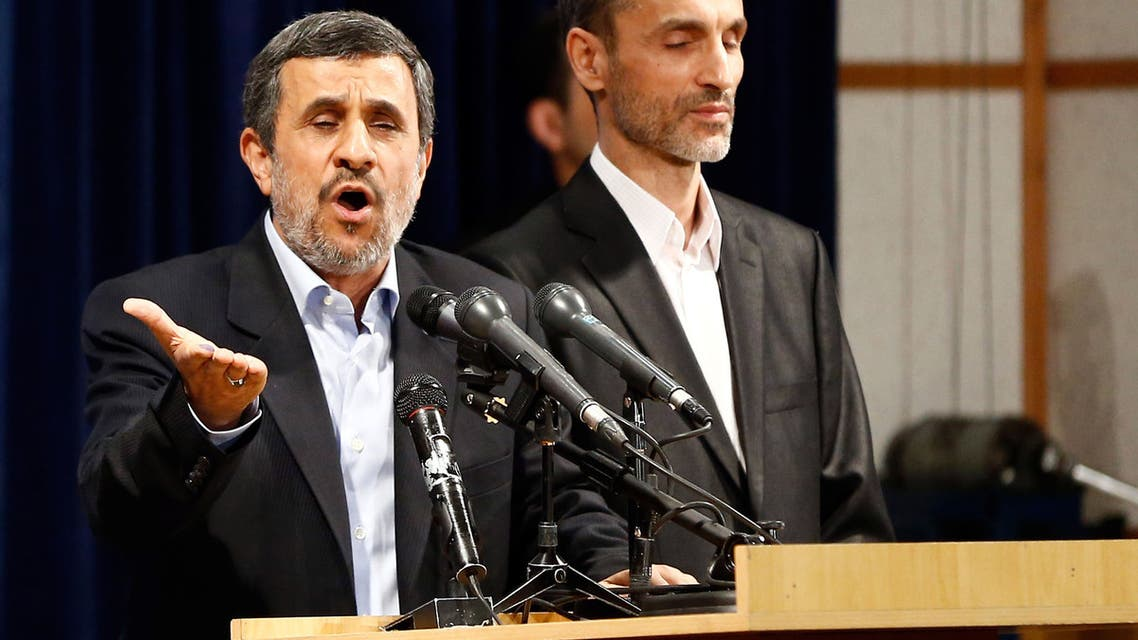 Former Iranian president Mahmoud Ahmadinejad (L) speaks, as he is accompanied by former Iranian Vice President Hamid Baghaei, after registering at the Interior Ministry's election headquarters as candidates begin to sign up for the upcoming presidential elections in Tehran on April 12, 2017. Ahmadinejad had previously said he would not stand after being advised not to by supreme leader Ayatollah Ali Khamenei, saying he would instead support his former deputy Hamid Baghaie who also registered on Wednesday.