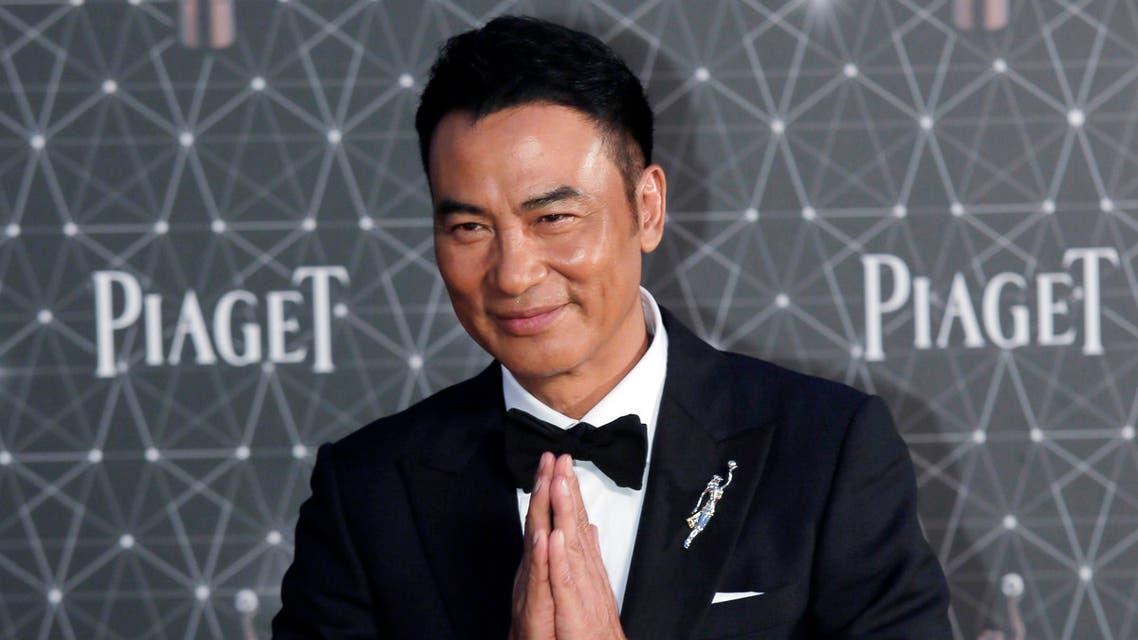 Hong Kong actor Simon Yam poses on the red carpet of the Hong Kong Film Awards in Hong Kong. (AP)