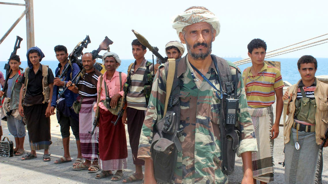 Huthi rebels stand at attention at the Saleef port on May 11, 2019, in the Red Sea port of Hodeidah, ahead of their withdrawal. A senior pro-government official in Yemen accused Huthi rebels of faking an announced pullout Saturday from three Red Sea ports, as a UN source said monitoring of the much delayed withdrawal in Hodeida province was underway.