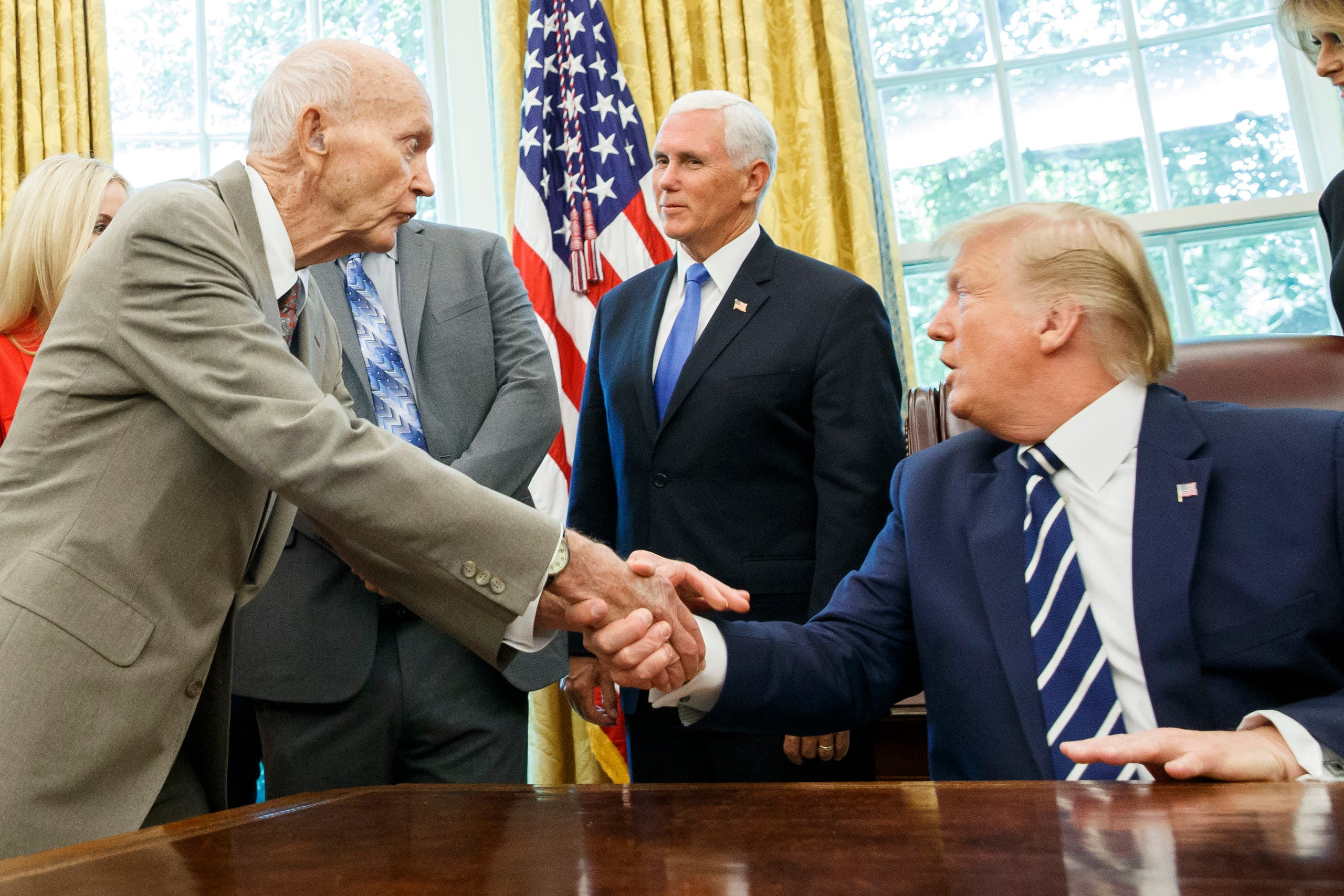 President Donald Trump shakes hands with Apollo 11 astronaut Michael Collin during a photo opportunity commemorating the 50th anniversary of the Apollo 11 moon landing. (AP)