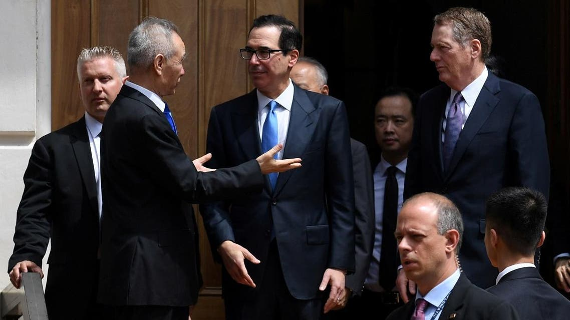 Chinese Vice Premier Liu He talks with US Treasury Secretary Steven Mnuchin and Trade Representative Robert Lighthizer as he leaves trade talks in Washington, on May 10, 2019. (Reuters)