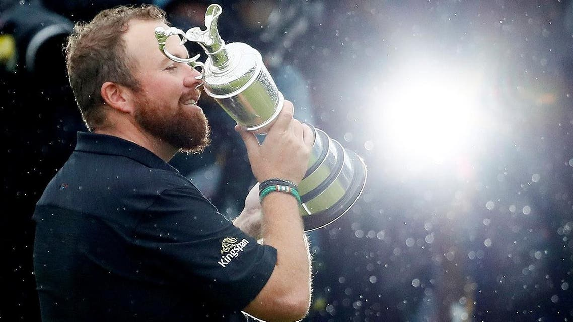 Shane Lowry celebrates with the Claret Jug trophy after winning The Open Championship at the Royal Portrush Golf Club, Portrush, Northern Ireland, on July 21, 2019. (Reuters)