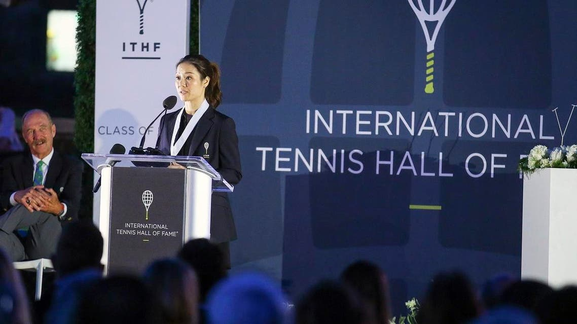 Tennis Hall of Fame inductee Li Na, of China, speaks to the crowd during ceremonies at the International Tennis Hall of Fame. (AP)
