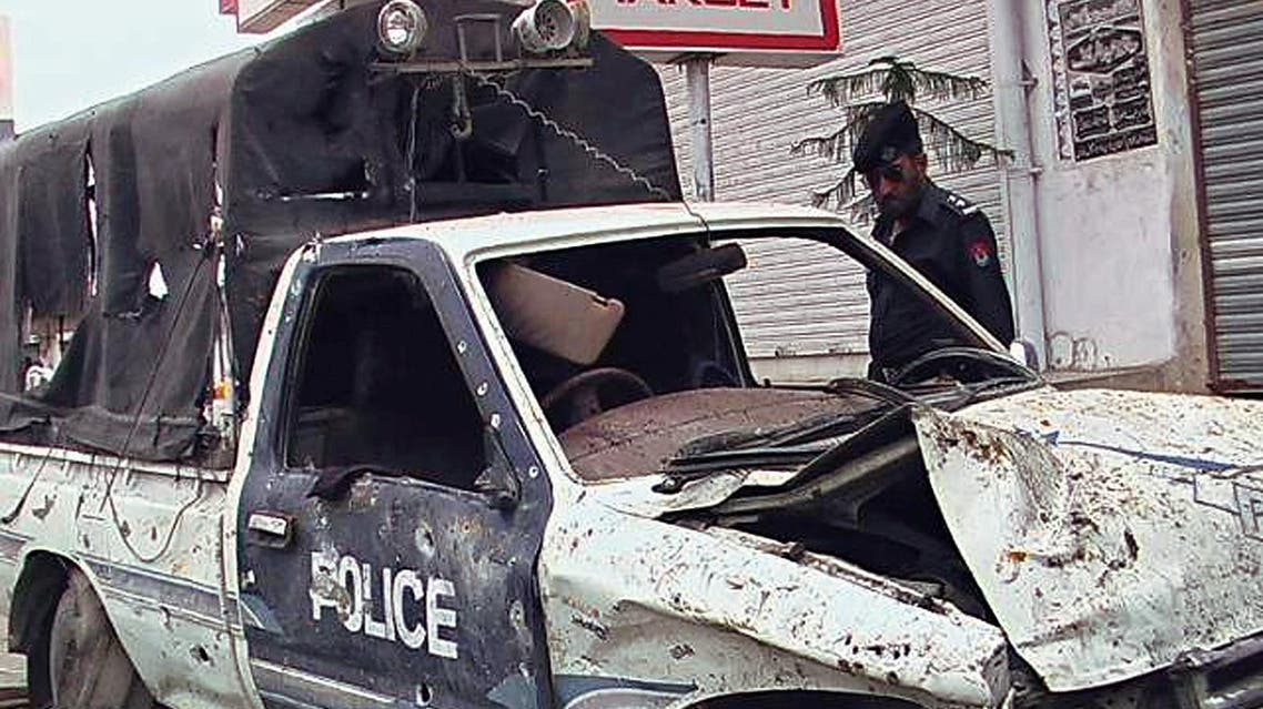 A Pakistani police officer examines a damaged vehicle after the bomb blast in Dera Ismail Khan, about 290 kilometers (180 miles) southwest of the capital Islamabad, Pakistan, on Sunday, March 19, 2006. (AP)
