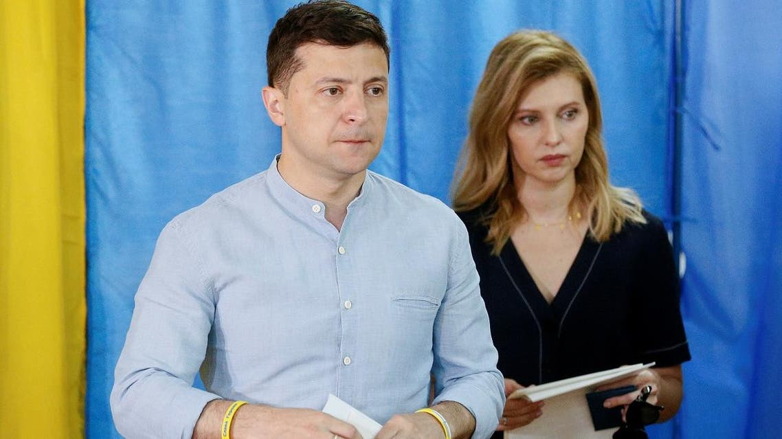 Ukraine's President Volodymyr Zelenskiy and his wife Olena walk before casting their ballots at a polling station during a parliamentary election in Kiev, Ukraine, on July 21, 2019. (Reuters)