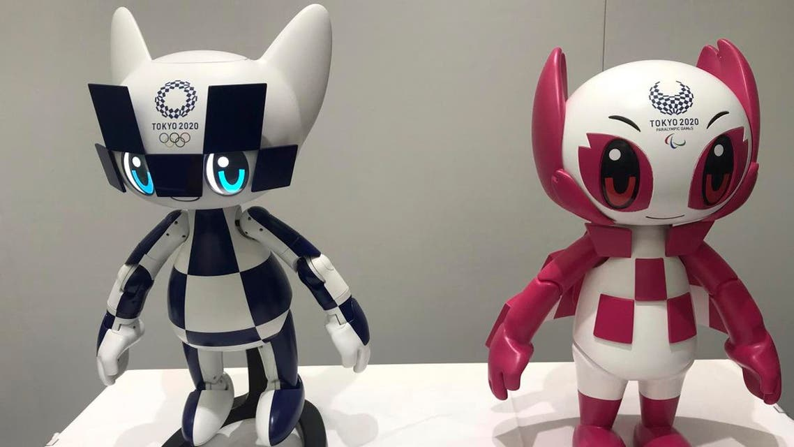 """Robots of mascots of Olympics """"Miraitowa,"""" left, and Paralympics """"Someity"""" are shown to the media at Toyota Motor Corp. headquarters in Tokyo. (AP)"""