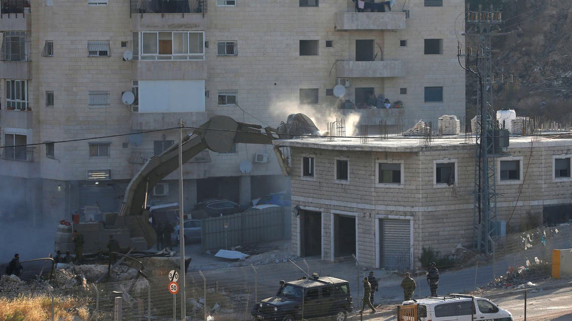 An Israeli machinery demolishes a Palestinian building in the village of Sur Baher which sits on either side of the Israeli barrier in East Jerusalem and the Israeli-occupied West Bank July 22, 2019. REUTERS
