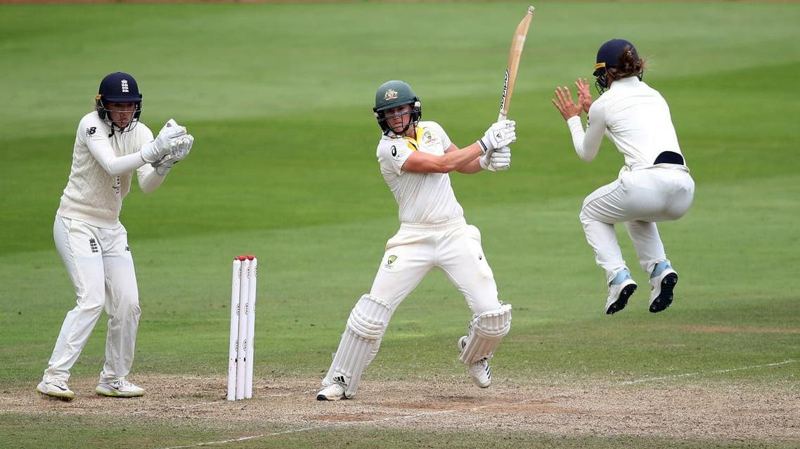 Australia's Ellyse Perry in action as England's Sarah Taylor looks on in the Women's Ashes  Test match at Taunton, Britain, on July 21, 2019. (Reuters)