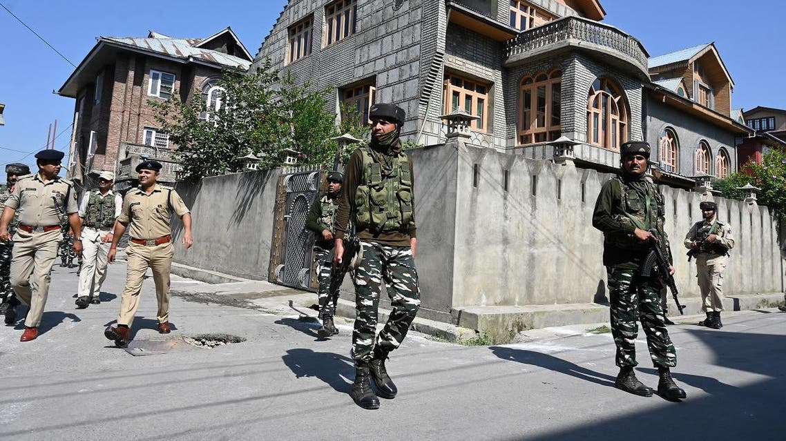 Indian paramilitary troopers patrol along a street before before the arrival of Indian Union Home Minister Amit Shah to visit family members of slain police officer Arshad Khan, who was killed during attack by militants in Anantnag in south of Srinagar, in Srinagar on June 27, 2019. (AFP)