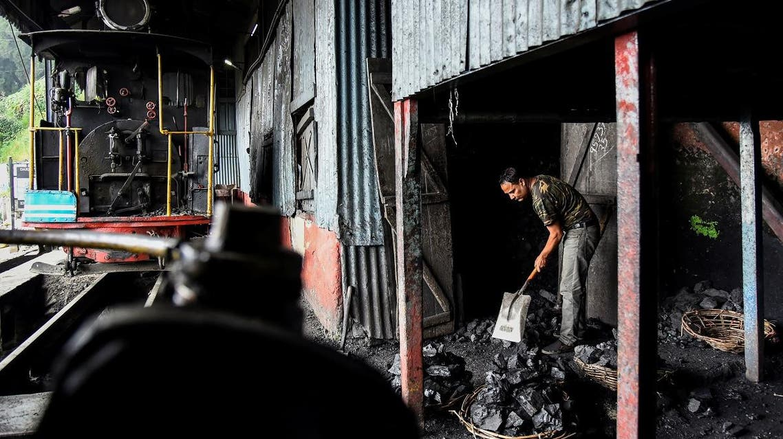 A worker breaks coal for a steam engine belonging to Darjeeling Himalayan Railway, which run on a 2 foot gauge railway and is a UNESCO World Heritage Site, at a statopm in Darjeeling. (Reuters)