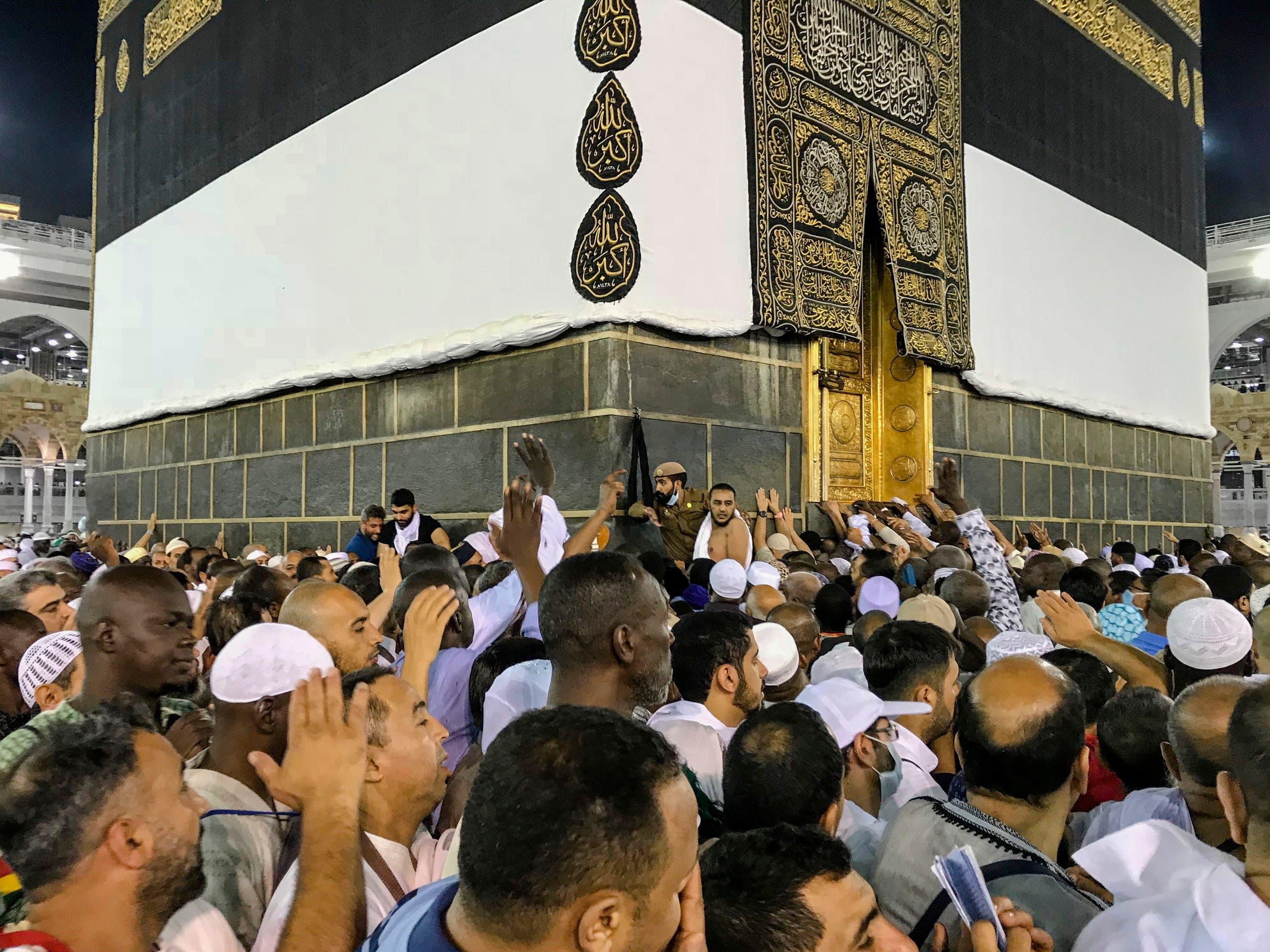 Muslim pilgrims circle the Kaaba (AP)