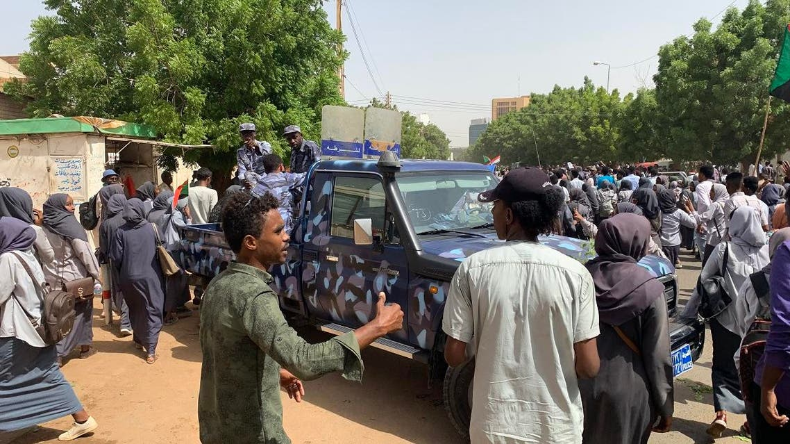 Sudanese protesters march past a security forces' vehicle during a demonstration commemorating protesters killed in past clashes, in the center of the capital Khartoum on July 23, 2019. (AFP)