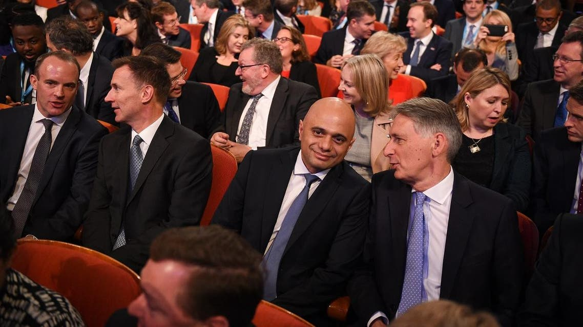 Members of the cabinet: (front row L-R) Britain's Secretary of State for Exiting the European Union (Brexit Minister) Dominic Raab, Britain's Foreign Secretary Jeremy Hunt, Britain's Home Secretary Sajid Javid, Britain's Chancellor of the Exchequer Philip Hammond as they wait for Britain's Prime Minister Theresa May to give her keynote address on the fourth and final day of the Conservative Party Conference 2018 AFP