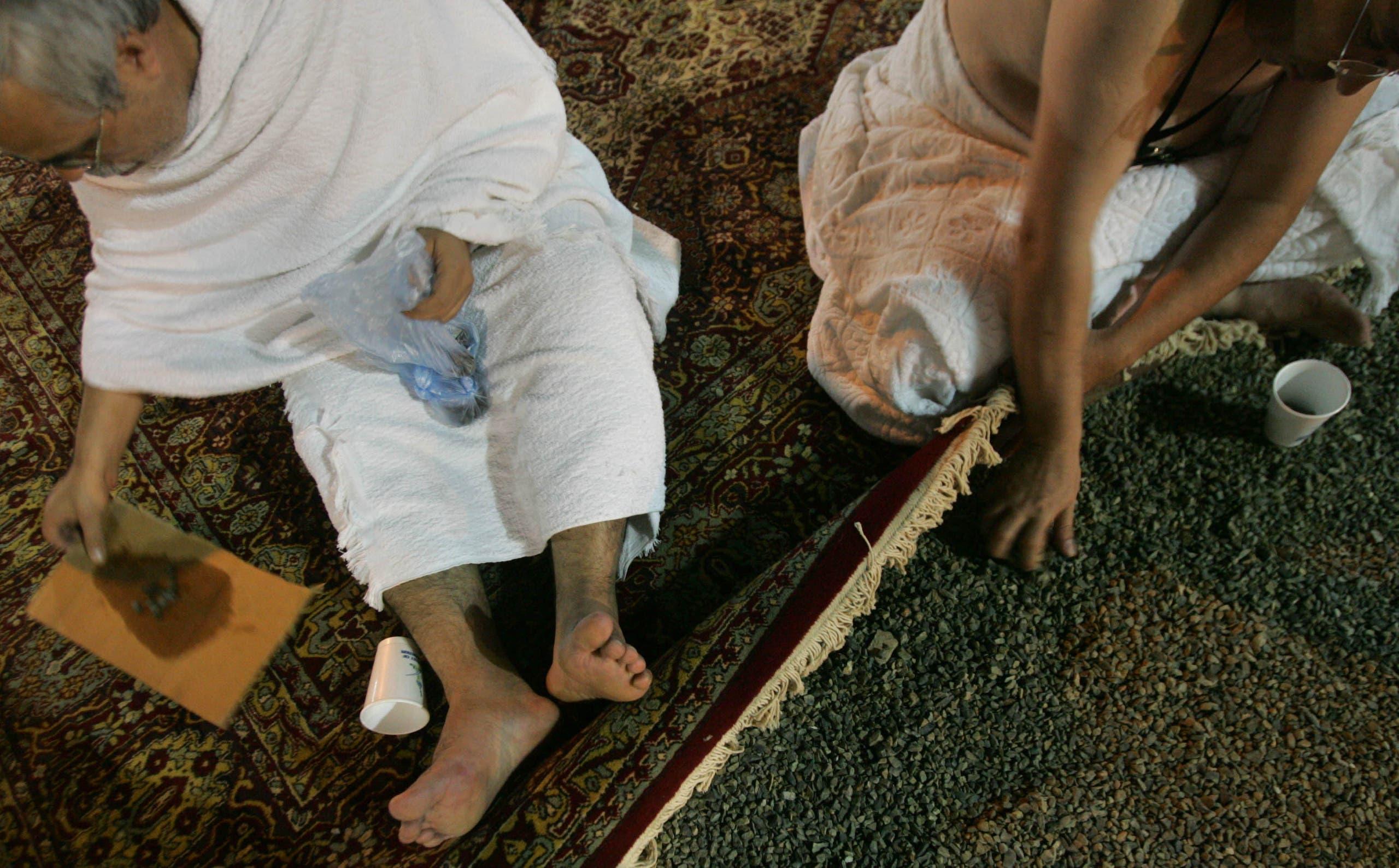 Muslim pilgrims collect stones to be thrown at a pillar representing the devil in Muzdalifah. (AP)