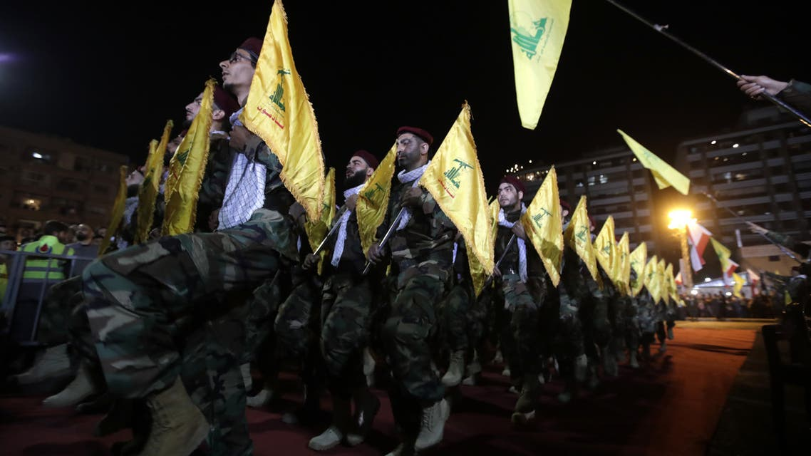 Fighters with the Lebanese Shiite Hezbollah party, carry flags as they parade in a southern suburb of the capital Beirut, to mark the al-Quds (Jerusalem) International Day, on May 31, 2019. An initiative started by the late Iranian revolutionary leader Ayatollah Ruhollah Khomeini, Quds Day is held annually on the last Friday of the Muslim fasting month of Ramadan and calls for Jerusalem to be returned to the Palestinians.