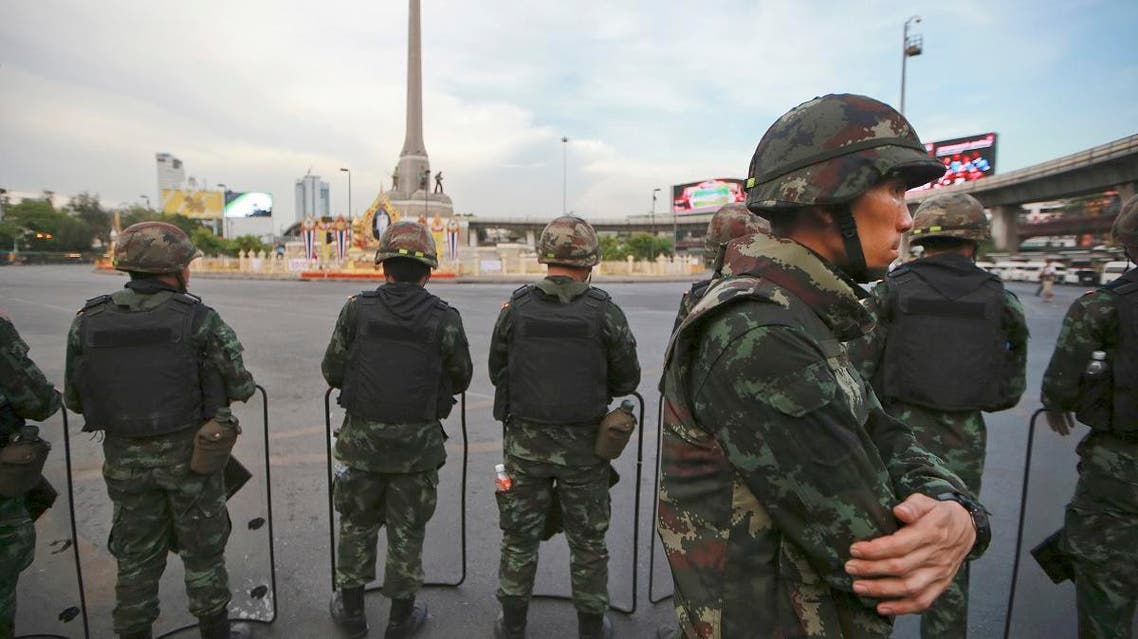 In this May 29, 2014, file photo, Thai soldiers guard an area to prevent an anti-coup demonstration at Victory Monument in Bangkok, Thailand. (AP)