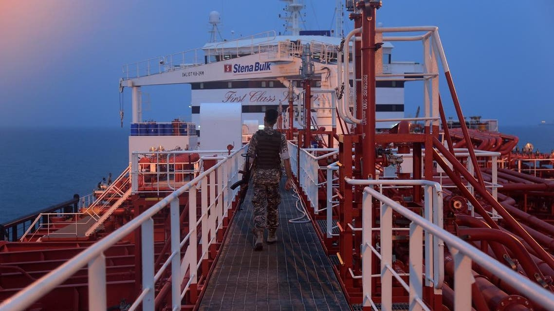 An Iranian Revolutionary Guard member walks onboard of Stena Impero, a British-flagged vessel owned by Stena Bulk, in Bandar Abbas port. (Reuters)