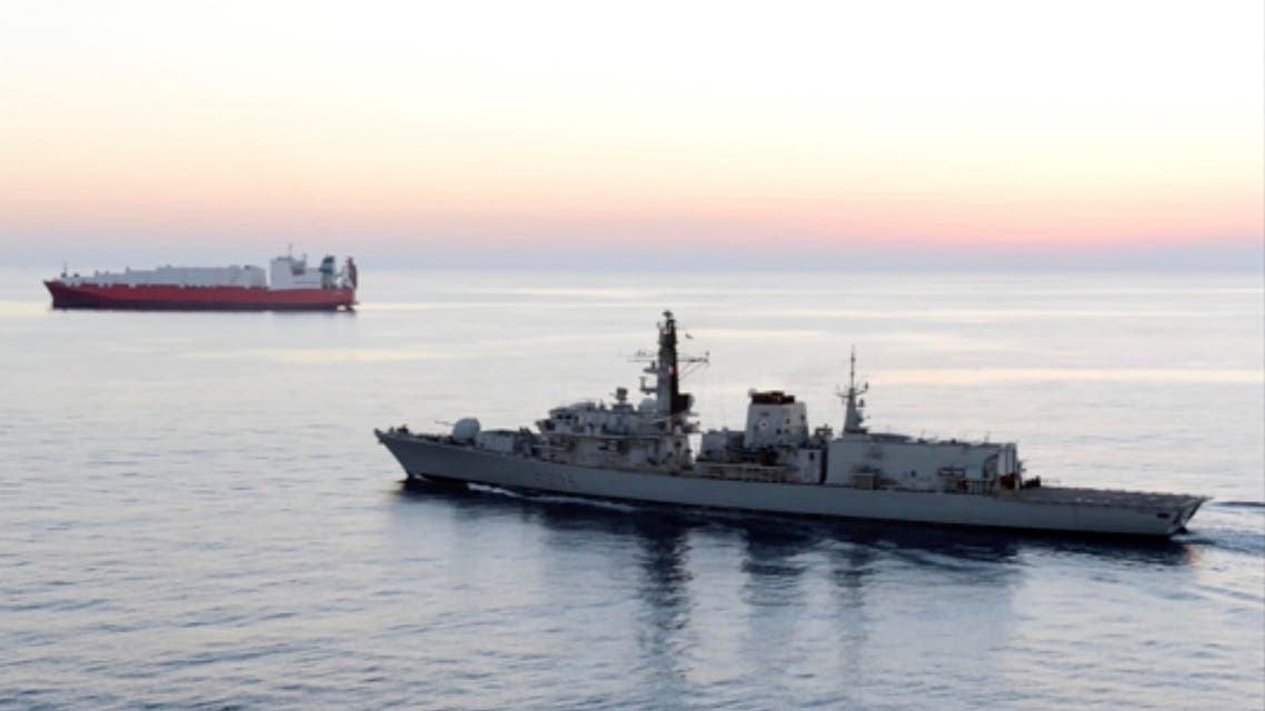 In this image from file video provided by UK Ministry of Defence, British navy vessel HMS Montrose escorts another ship during a mission to remove chemical weapons from Syria at sea off coast of Cyprus in February 2014. (AP)