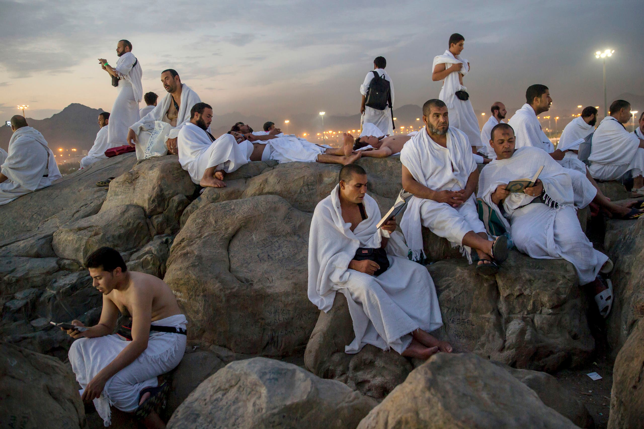 Muslim pilgrims pray on the Jabal Al Rahma holy mountain, or the mountain of forgiveness, at Arafat for the annual hajj pilgrimage outside the holy city of Mecca (AP)